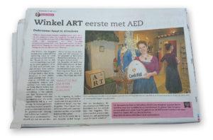 Karin van Boggelen  van Art Den Bosch heeft een AED in haar winkel